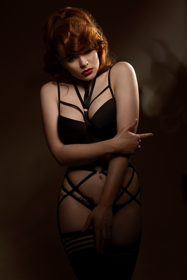 Lingerie by 'Playful Promises' and harness by 'Malice Lingerie'